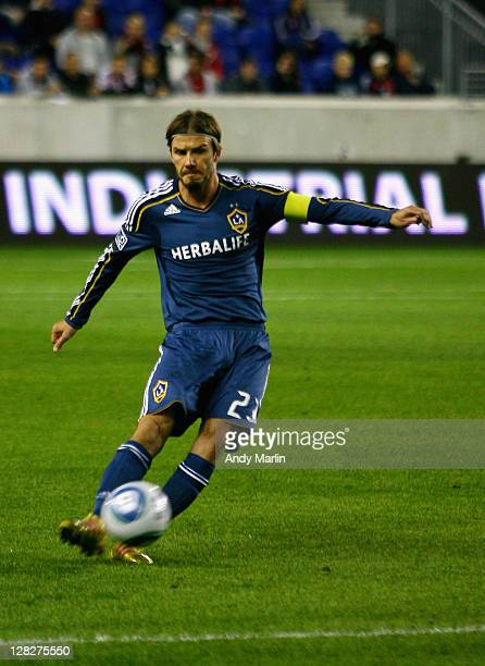David Beckham of the Los Angeles Galaxy plays the ball against the New York Red Bulls during the game at Red Bull Arena on October 4 2011 in Harrison...