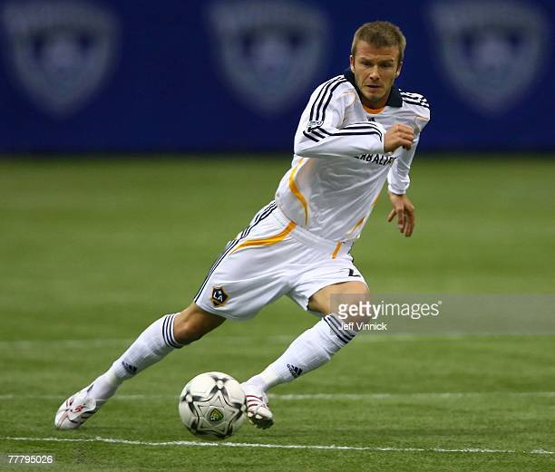 David Beckham of the Los Angeles Galaxy plays the ball during their exhibition soccer match against the Vancouver Whitecaps at BC Place Stadium on...