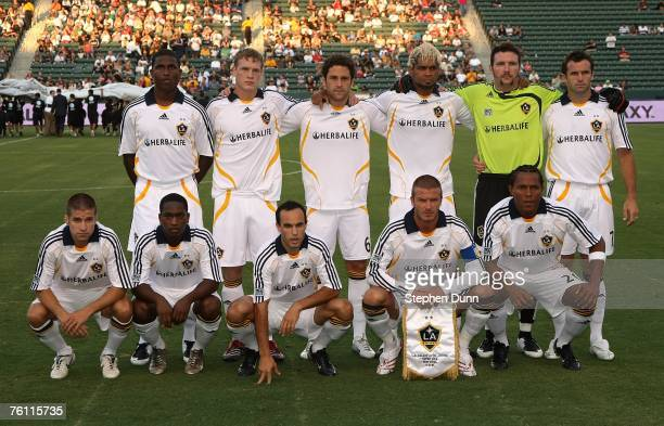 David Beckham of the Los Angeles Galaxy poses with his teammates for a team photo before his first start in the Superliga match against DC United at...