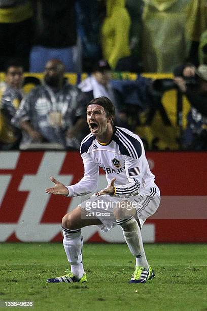 David Beckham of the Los Angeles Galaxy reacts after a goal by Landon Donovan giving the Galaxy a 10 lead against the Houston Dynamo in the second...