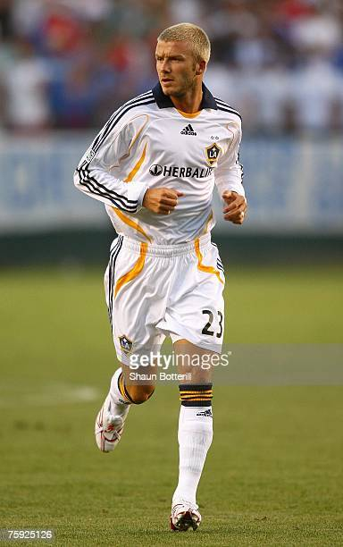 David Beckham of the Los Angeles Galaxy runs into position shortly after entering the game in the World Series of Football match against Chelsea FC...