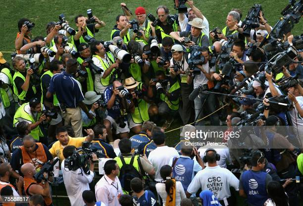 David Beckham of the Los Angeles Galaxy sits on the bench as photographers take his picture before the World Series of Football match against Chelsea...