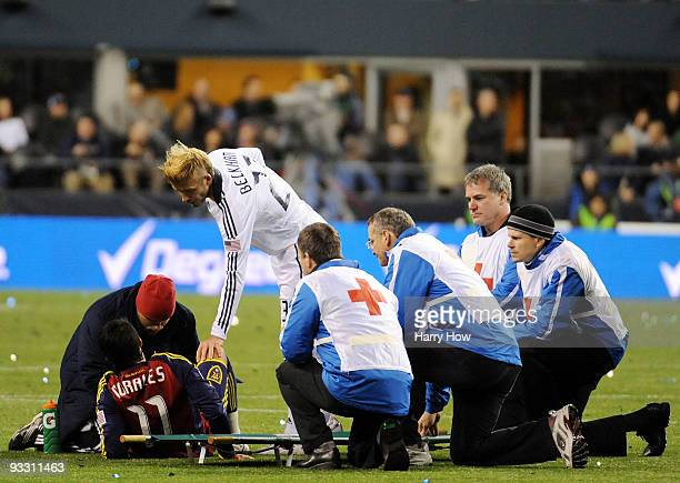 David Beckham of the Los Angeles Galaxy speaks with Javier Morales of Real Salt Lake as he is attended to by medical staff during the MLS Cup final...