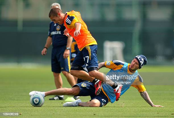 David Beckham of the Los Angeles Galaxy tackles teammate Bryan Jordan during training at The Home Depot Center on February 24 2011 in Carson...