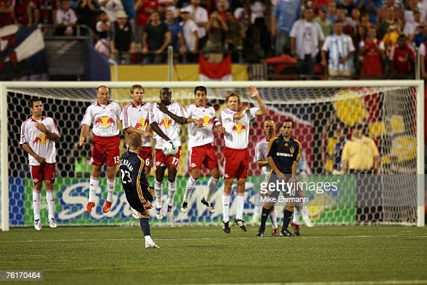 David Beckham of the Los Angeles Galaxy takes a free kick against the New York Red Bulls at Giants Stadium on August 18, 2007 in East Rutherford, New...