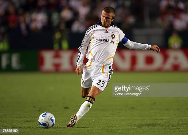 David Beckham of the Los Angeles Galaxy takes a free kick in the first half of their MLS match against CD Chivas USA at the Home Depot Center on...