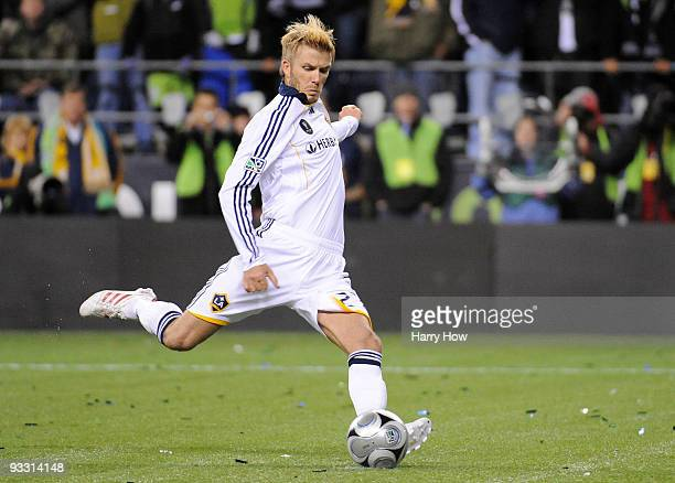 David Beckham of the Los Angeles Galaxy takes a penalty kick against Real Salt Lake in the shootout following regulation time in the MLS Cup final at...