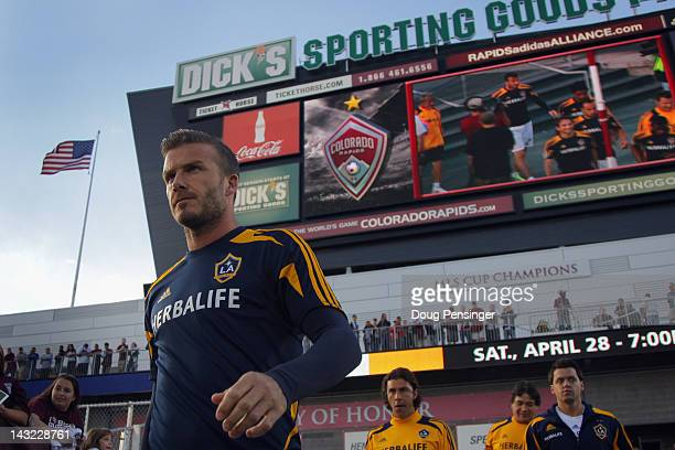 David Beckham of the Los Angeles Galaxy takes the field for warm up prior to facing the Colorado Rapids at Dick's Sporting Goods Park on April 21...