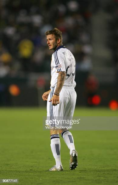 David Beckham of the Los Angeles Galaxy walks back upfield during the MLS match against FC Dallas at The Home Depot Center on September 12 2009 in...