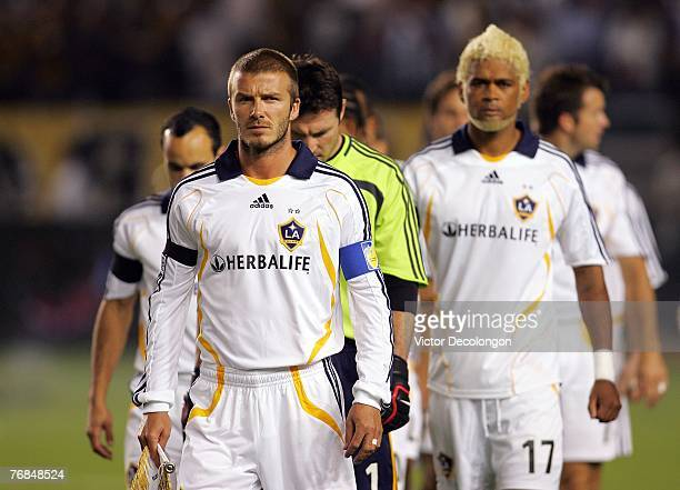 David Beckham of the Los Angeles Galaxy walks through the field with teammates just prior to the start of their SuperLiga Final match against Pachuca...