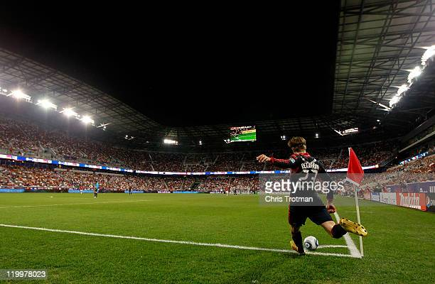 David Beckham of the MLS All-Stars shoots a corner kick against the Manchester United during the first half of the MLS All-Star Game at Red Bull...