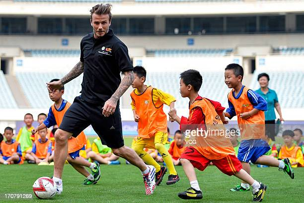 David Beckham plays football with children at at Nanjing Olympic Sports Center on June 18 2013 in Nanjing Jiangsu Province of China