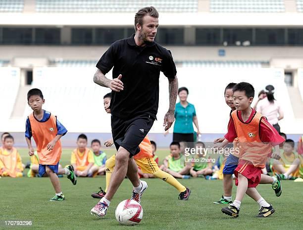 David Beckham plays football with children at Nanjing Olympic Sports Center on June 18, 2013 in Nanjing, Jiangsu Province of China.