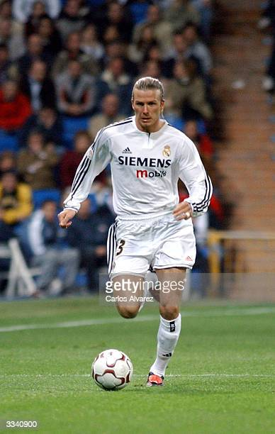 David Beckham plays with the ball while on the field during the football match between Real Madrid and Osasuna on April 11 2004 at Santiago Bernabeu...
