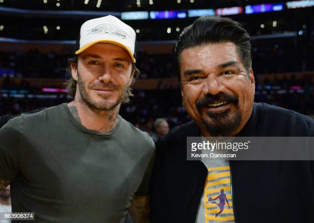 David Beckham poses comedian George Lopez during Memphis Grizzlies and Los Angeles Lakers basketball game at Staples Center April 2 2017 in Los...
