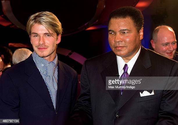 David Beckham poses for a photograph with Muhammad Ali winner of the BBC's Sports Personality of the Century Award as they attend the BBC Sports...