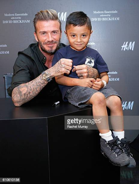 David Beckham poses for photos with fans during the launch of David Beckham's HM Modern Essentials Collection on September 26 2016 in HM at FIGat7th...