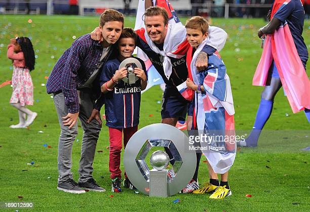 David Beckham poses wih the Ligue 1 trophy and his sons, Brooklyn, Romeo and Cruz during the Ligue 1 match between Paris Saint-Germain FC and Stade...