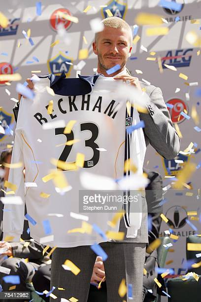 David Beckham poses with his new Galaxy jersey at the Home Depot Stadium where he was officially announced as a LA Galaxy Player at the Home Depot...