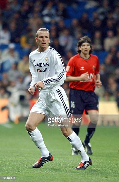 David Beckham runs on the field during the football match between Real Madrid and Osasuna on April 11 2004 at Santiago Bernabeu in Madrid Spain