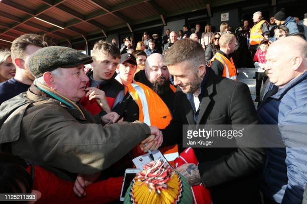 David Beckham Salford City coowner signs autographs for fans prior to the Vanarama National League match between Salford City and Dover Athletic at...