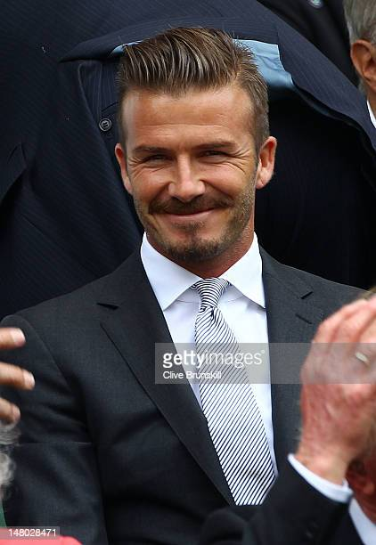 David Beckham sits in the Royal Box during the Gentlemen's Singles final match between Roger Federer of Switzerland and Andy Murray of Great Britain...