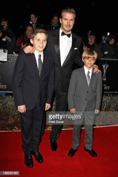 David Beckham, sons Brooklyn Beckham and Romeo Beckham attend The Sun Military Awards at Imperial War Museum on December 19, 2011 in London, England.