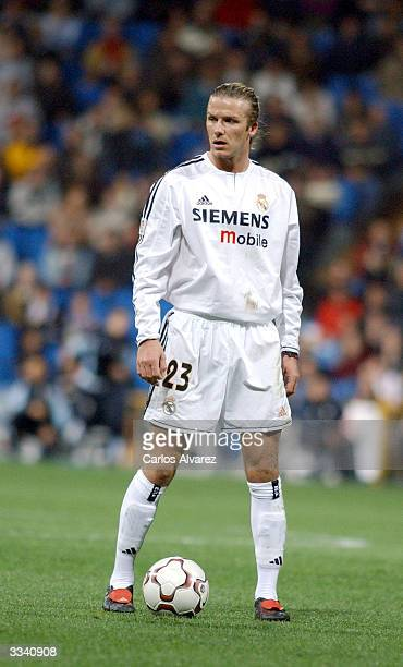 David Beckham stands next to the ball while on the field during the football match between Real Madrid and Osasuna on April 11 2004 at Santiago...