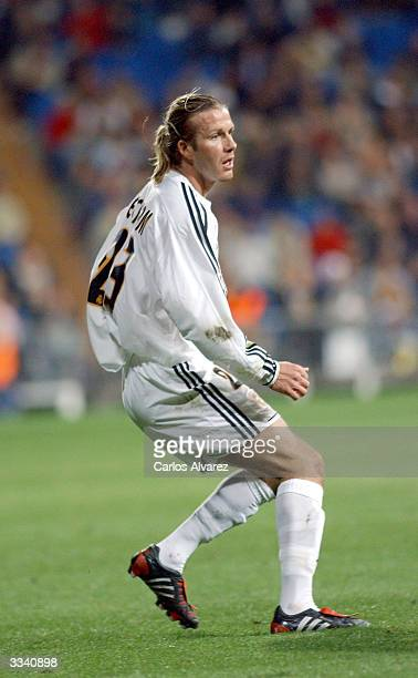 David Beckham stands on the field during the football match between Real Madrid and Osasuna on April 11 2004 at Santiago Bernabeu in Madrid Spain