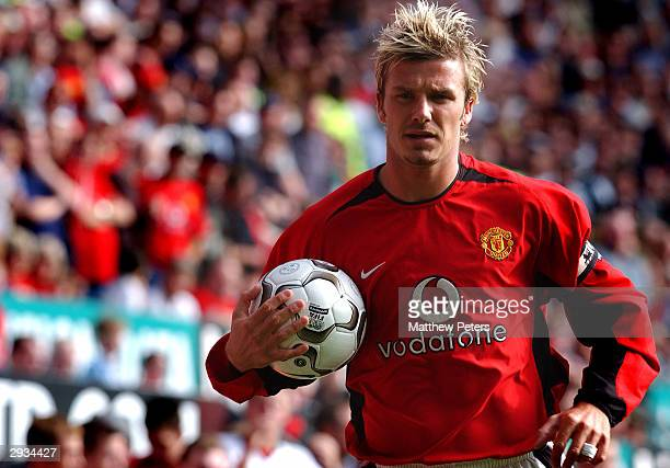 David Beckham takes the ball for a corner during the FA Barclaycard Premiership match between Manchester United v Tottenham Hotspur at Old Trafford...