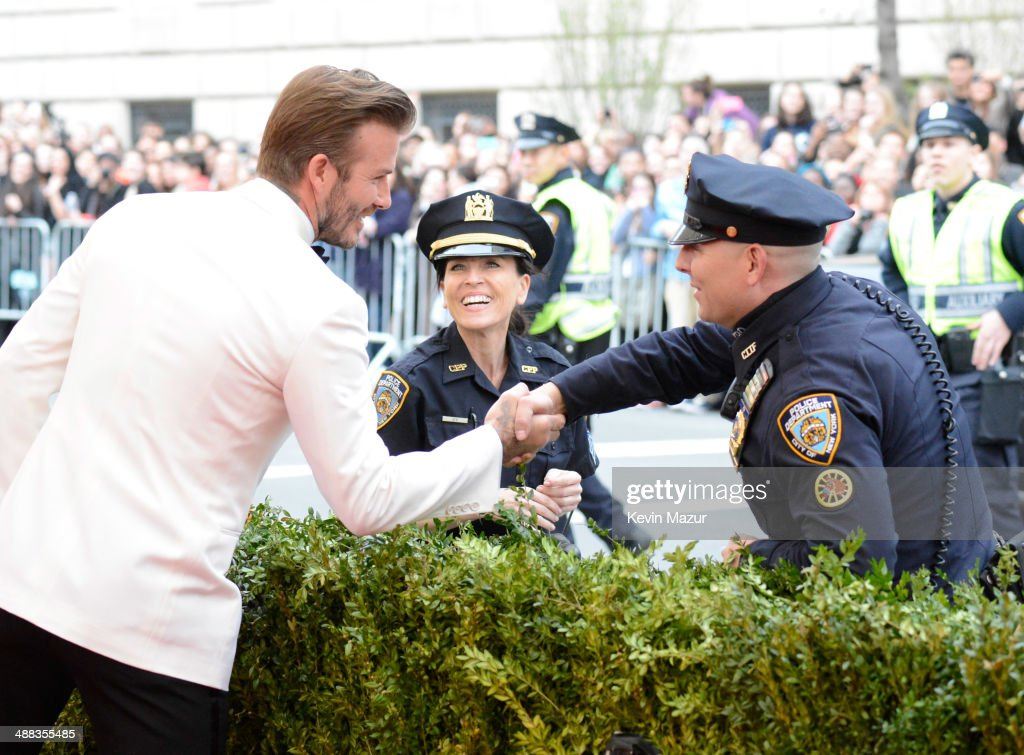 David Beckham talks to police officers the 'Charles James: Beyond Fashion' Costume Institute Gala at the Metropolitan Museum of Art on May 5, 2014 in New York City.