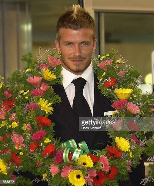 David Beckham the England captain is presented with a garland as he and the England team arrive at Jeju International Airport Korea on May 19 2002...