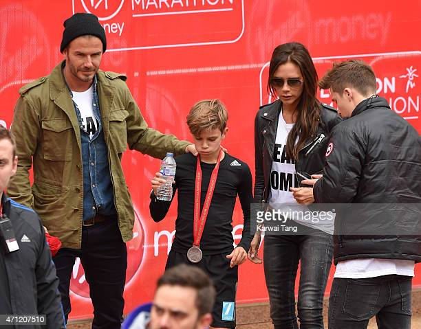 David Beckham Victoria Beckham and Brooklyn Beckham congratulate Romeo Beckham after he finished the Childrens Marathon during the London Marathon on...