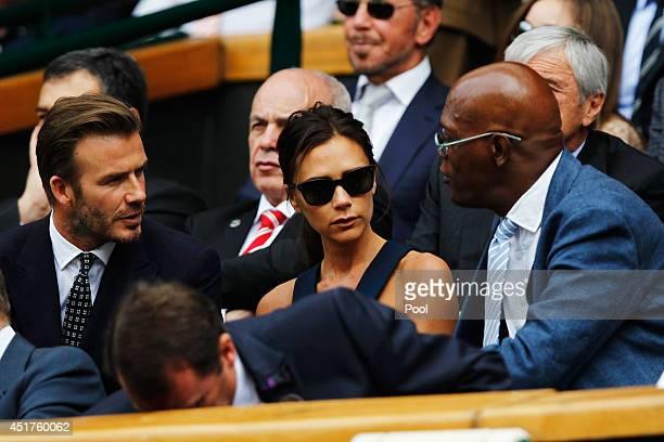 David Beckham Victoria Beckham and Samuel L Jackson in the Royal Box on Centre Court before the Gentlemen's Singles Final match between Roger Federer...