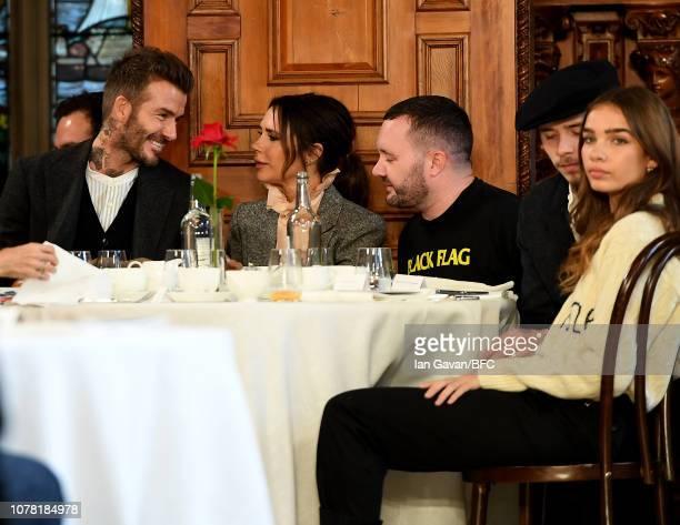 David Beckham Victoria Beckham Kim Jones Brooklyn Beckham and Hana Cross attend the Kent Curwen presentation during London Fashion Week Men's January...