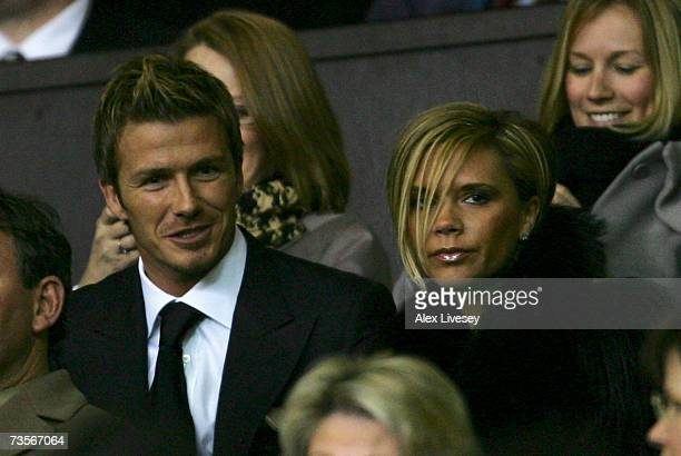 David Beckham waits for the action to begin with his wife Victoria prior to the start of the UEFA Celebration match between Manchester United and...
