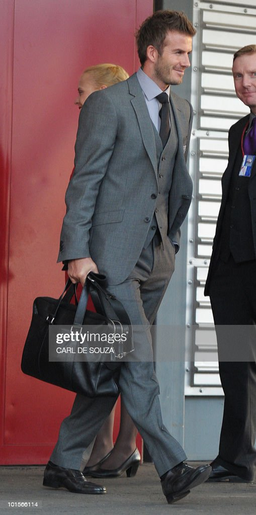 David Beckham walks towards a plane before boarding it with the England football team for South Africa at Heathrow airport, London, on June 2, 2010.