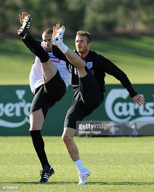 David Beckham warms up alongside Matthew Upson during an England training session at London Colney on March 2, 2010 in St Albans, England.