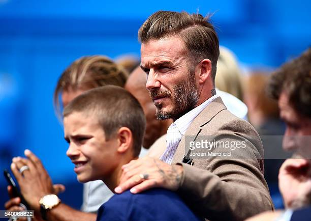 David Beckham watches the action with his son Romeo Beckham during day two of the Aegon Championships at The Queens Club on June 14 2016 in London...