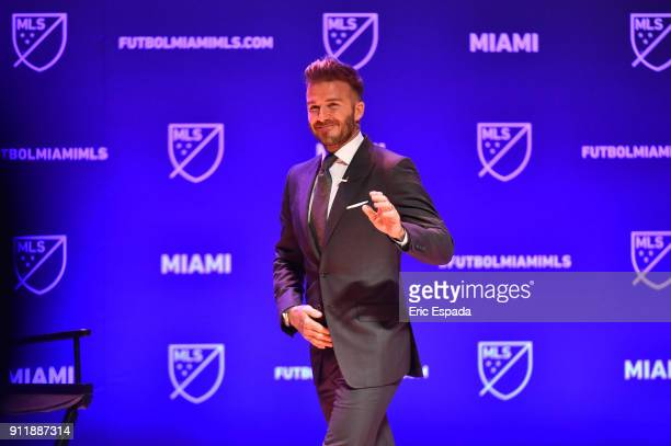 David Beckham waves to the crowd at the beginning of the press conference awarding Miami with an MLS franchise at the Knight Concert Hall on January...