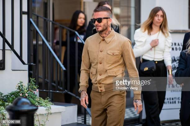 4b488b0f28 David Beckham wearing brown beige button shirt and pants is seen outside Kent  Curwen during London