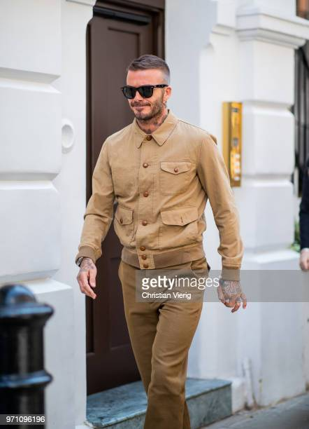 David Beckham wearing brown beige button shirt and pants is seen outside Kent Curwen during London Fashion Week Men's June 2018 on June 10 2018 in...