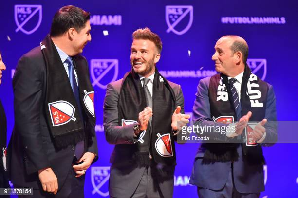 David Beckham with Don Garber MLS Commissioner and Marcelo Claure CEO of Sprint after being presented with a scarf after officially awarding the City...