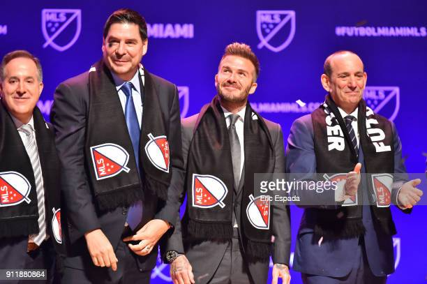 David Beckham with Don Garber MLS Commissioner Marcelo Claure CEO of Sprint and Jorge Mas Chairman and cofounder of MasTec after being presented with...