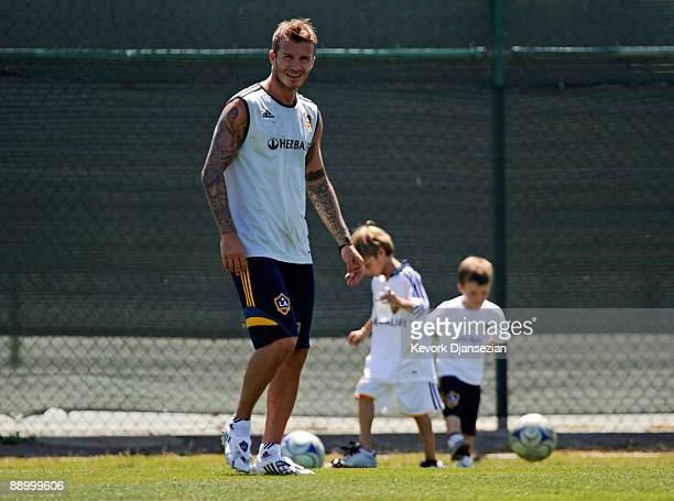 David Beckham with his children Romeo Beckham and Cruz Beckham looking on practices with the Los Angeles Galaxy for the first time this year...