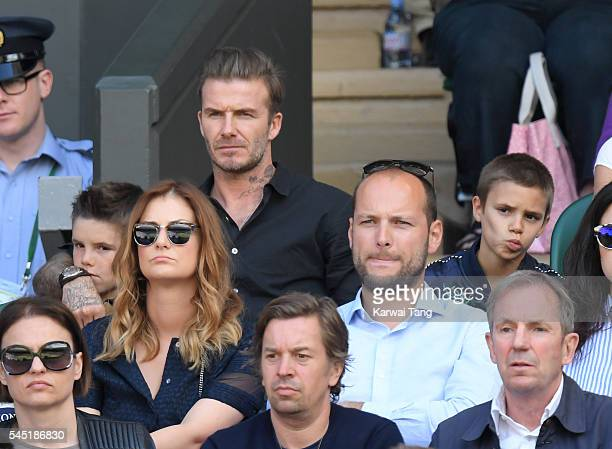 David Beckham with sons Cruz and Romeo attend day nine of the Wimbledon Tennis Championships at Wimbledon on July 06, 2016 in London, England.