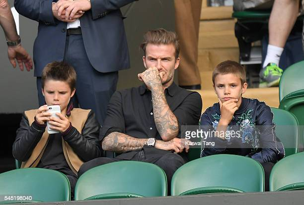 David Beckham with sons Cruz and Romeo attend day nine of the Wimbledon Tennis Championships at Wimbledon on July 06 2016 in London England