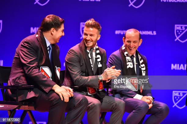 David Beckham with Sprint CEO Marcelo Claure and MLS Commissioner Don Garber during the press conference announcing an MLS franchise in Miami at the...