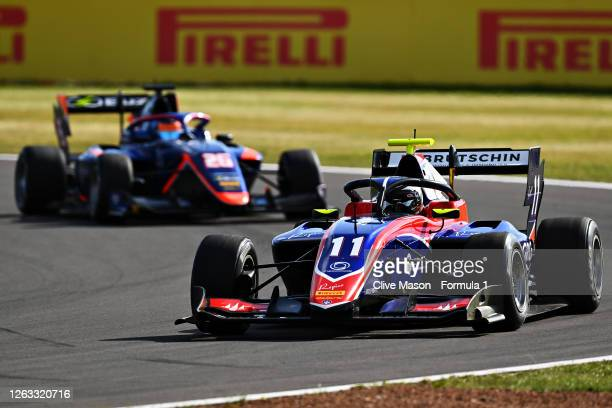 David Beckmann of Germany and Trident leads Clement Novalak of Great Britain and Carlin Buzz Racing during race two of the Formula 3 Championship at...