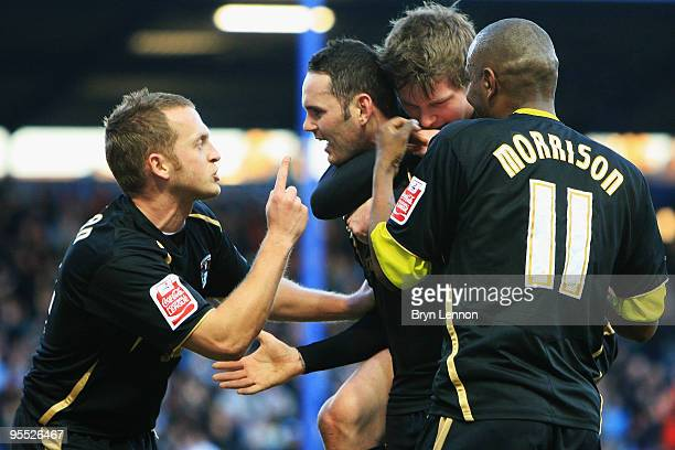 David Bell of Coventry City celebrates with team mates after scoring during the FA Cup 3rd Round match between Portsmouth and Coventry City at...
